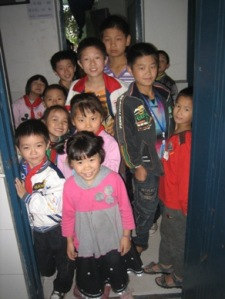 Students crowded in through the doorway to get a look at me as I took a picture of He Na's class